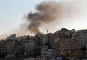 Smoke rises during sectarian clashes between Sunni Muslims and Alawites in Tripoli, northern Lebanon