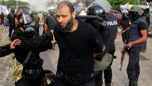 Secular Police arrest Islamic demonstrator in Egypt