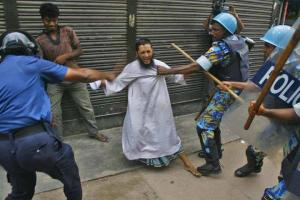 Secular Police beat up Islamic protester in Bangladesh